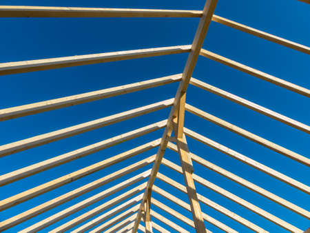 sponsors: in one house a new roof is built on a construction site. carrier wooden roof.