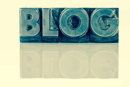 the word blog written with lead letters. photo
