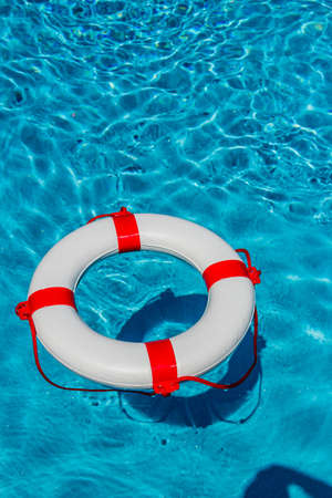 insolvency: an emergency tire floating in a swimming pool.