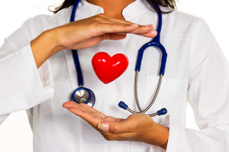 physicans: a young doctor (internist) symbolically holding a heart in his hand. Stock Photo