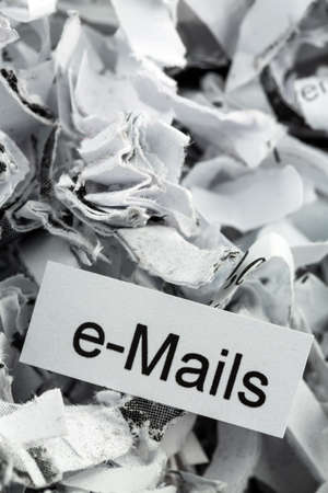 scandals: shredded paper tagged with e-mails, symbol photo for data destruction, mails and data flooding Stock Photo