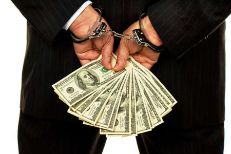 remand: manager with dollar bills in hand. crime in the economy