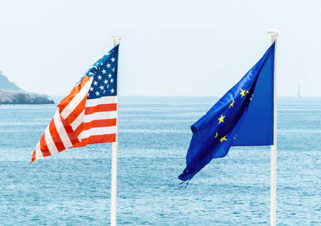bilateral: flags of the european union and the united states, symbol photo for partnership, diplomacy, foreign policy