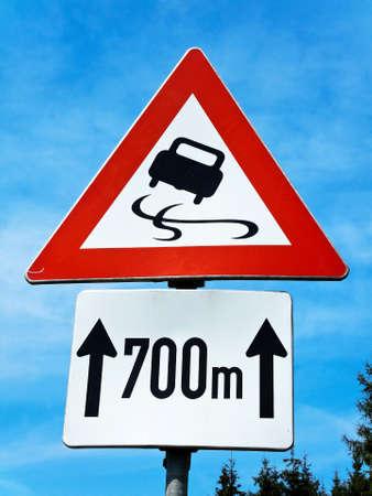 warning risk of skidding on slippery road photo