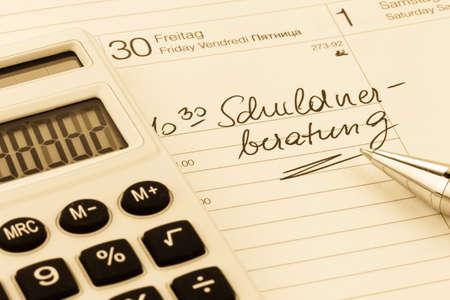 indebtedness: ingresso debito calendario, foto simbolo di fallimento personale e la povert� Archivio Fotografico