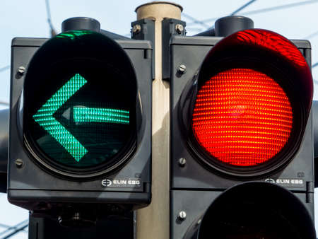 permitted: a traffic light with retoem light. green light for traffic turning left.