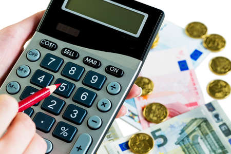 accounted for: hand with calculator and bills. symbol photo for sales, profits, taxes and costing