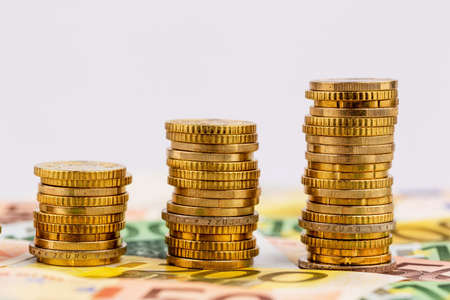 stacks of money coins rising curve, symbol photo for increasing profits and rising costs Stock Photo