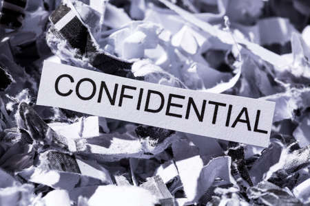 paper shredder: scraps of paper with the heading confidential, symbol photo for data destruction, banking secrecy and confidentiality
