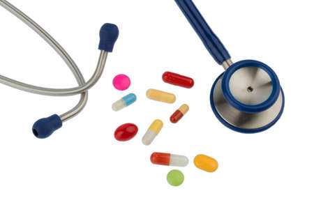 psychotropic medication: colorful tablets and stethoscope, symbol photo for diagnostics, heart disease and interactions Stock Photo