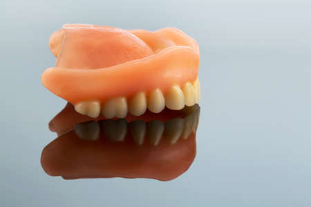dentition: dentition, symbol photo for dentures, diagnosis, and co-payment
