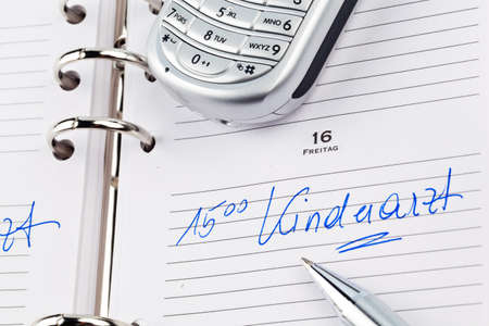 physicans: an appointment is entered in a calendar: pediatrician Stock Photo