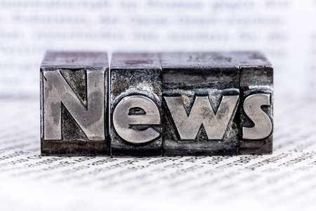 the word news written with lead letters. symbol photo for newsletters, newspapers and information photo