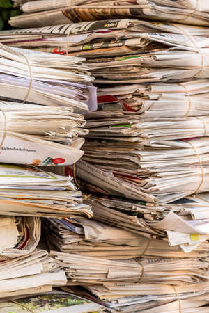 collects: a stack of old newspapers ready for removal by waste paper disposal Stock Photo