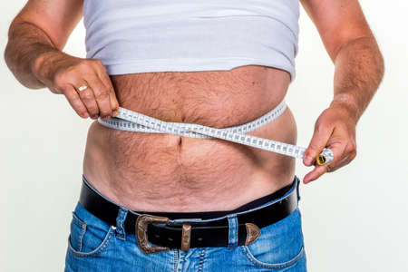 man with overweight. symbol photo for beer belly, unsuccessful diets and poor diet. photo