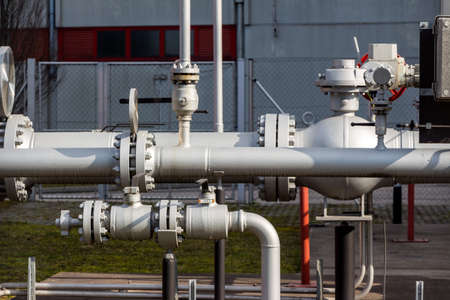 industrial district: pipelines at a district heating plant Stock Photo