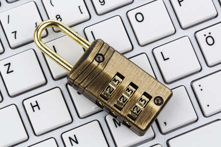 a padlock on a computer keyboard. symbol photo for data security and hacking photo