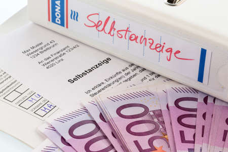 treaties: symbol photo for a voluntary due to evasion of taxes by the tax office in austria Stock Photo