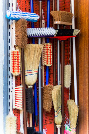 putz: cabinet with various kinds of broom