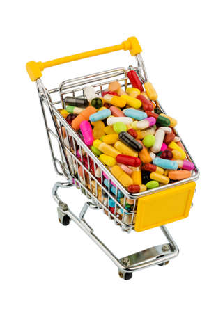 consumerist: tablets with shopping cart. symbol photo for the purchase of medicines on the internet Stock Photo