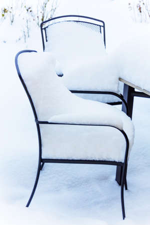 utilization: snow-covered garden furniture, symbol photo restaurants and hotels in winter, low utilization
