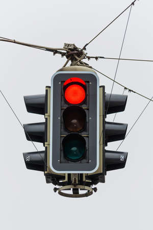 control panel lights: a traffic light with red light. symbol photo for maintenance, economy, failure