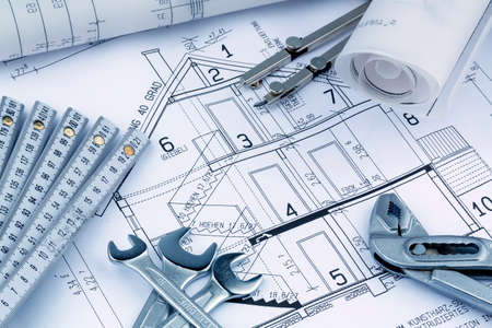 construction draftsman: an architects blueprint for the construction of a new residential house. symbol photo for financing and planning of a new home. Stock Photo