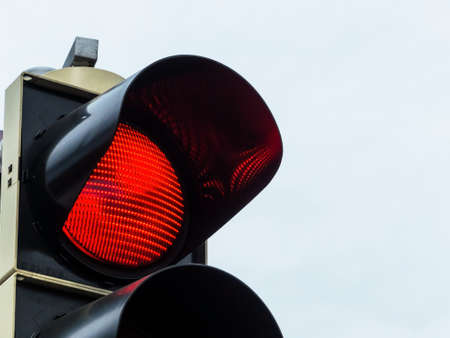 a traffic light shows red light. symbol photo for maintenance, exit and risk. Stock Photo