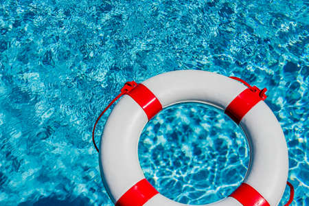 financial crisis: an emergency tire floating in a swimming pool. symbol photo for rescue and crisis management in the financial crisis and banking crisis.