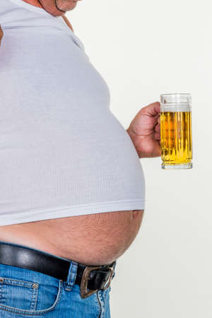constrict: man with overweight. symbol photo for beer belly, unsuccessful diets and poor diet. Stock Photo