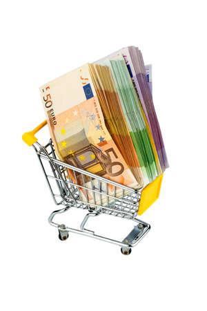 glut: euro bank notes in a shopping cart, photo icon for purchasing power, shopping, money printing and inflation
