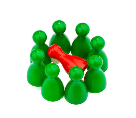 illegally: red and green characters. bullying, loneliness and outsider in the team. Stock Photo