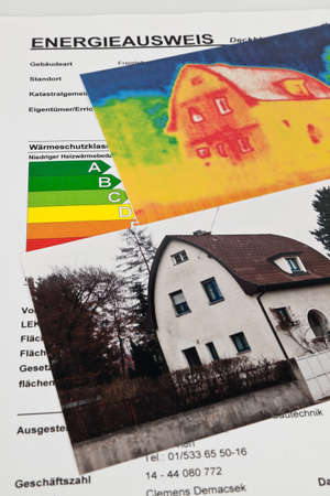 save energy through insulation. house with thermal imaging camera photographed. Stock Photo