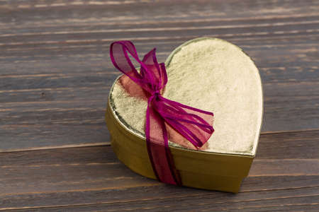 cordially: a box for a gift in the shape of a heart. symbol photo for valentines day, wedding anniversary, engagement.