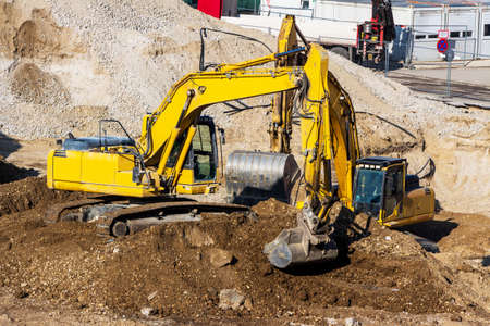 excavator on a construction site. bucket with soil, ground work.
