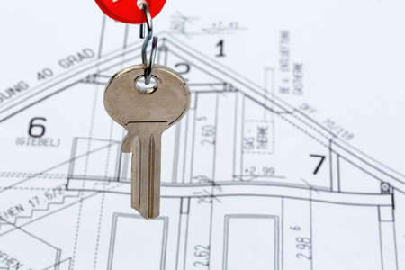 single familiy: an architects blueprint with the key of a home or a new home