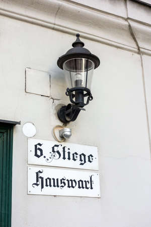 lodger: sign on a house in vienna. here the janitor or caretaker is areall. Stock Photo