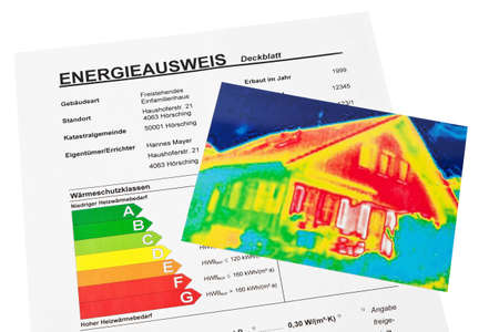 thermography: save energy through insulation. house with thermal imaging camera photographed.