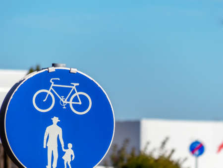 sign for bike path and walkway. each other on the road photo