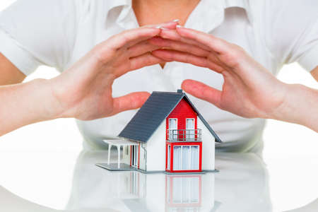 a woman protects your house and home. good insurance and reputable financing calm. photo