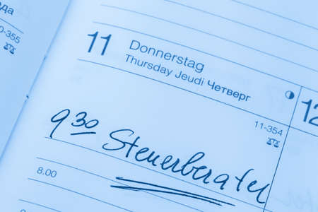 auditors: an appointment is entered in a calendar: tax consultant