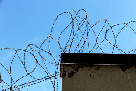 refugees: a plot of land is covered with barbed wire