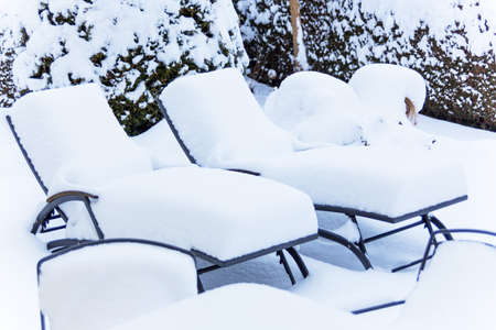 occupancy: snow-covered garden furniture, symbol photo restaurants and hotels in the winter, low utilization