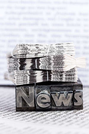 the word news written with lead letters. photo icon for newsletters, newspapers and information photo