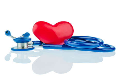 arrhythmias: a heart and a stethoscope lying next to each other. photo icon for heart disease and heartache. Stock Photo