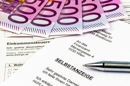 treaties: photo icon for a voluntary due to evasion of taxes by the tax office in austria Stock Photo