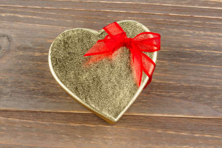 cordially: a box for a gift in the shape of a heart. photo icon for valentines day, wedding, engagement.