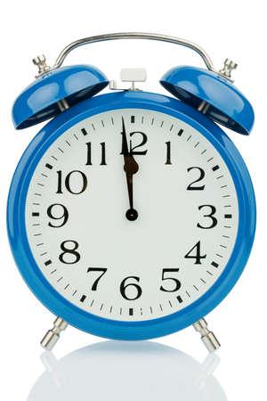 ultimatum: a blue alarm clock on white