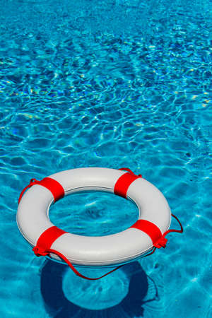 banking crisis: an emergency tire floating in a swimming pool. photo icon for rescue and crisis management in the financial crisis and banking crisis.