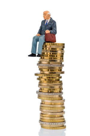 retirement money: pensioners sitting on money stack, symbol photo for retirement and pension